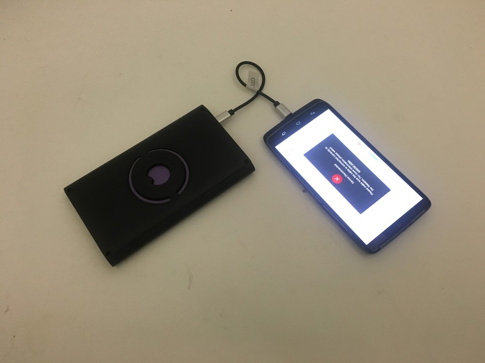 Picture of Walabot connected to a smartphone.