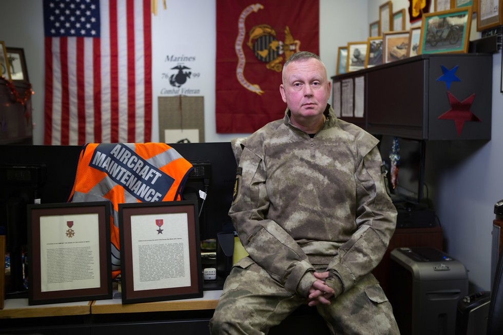 Don Larson in his military decorated office.