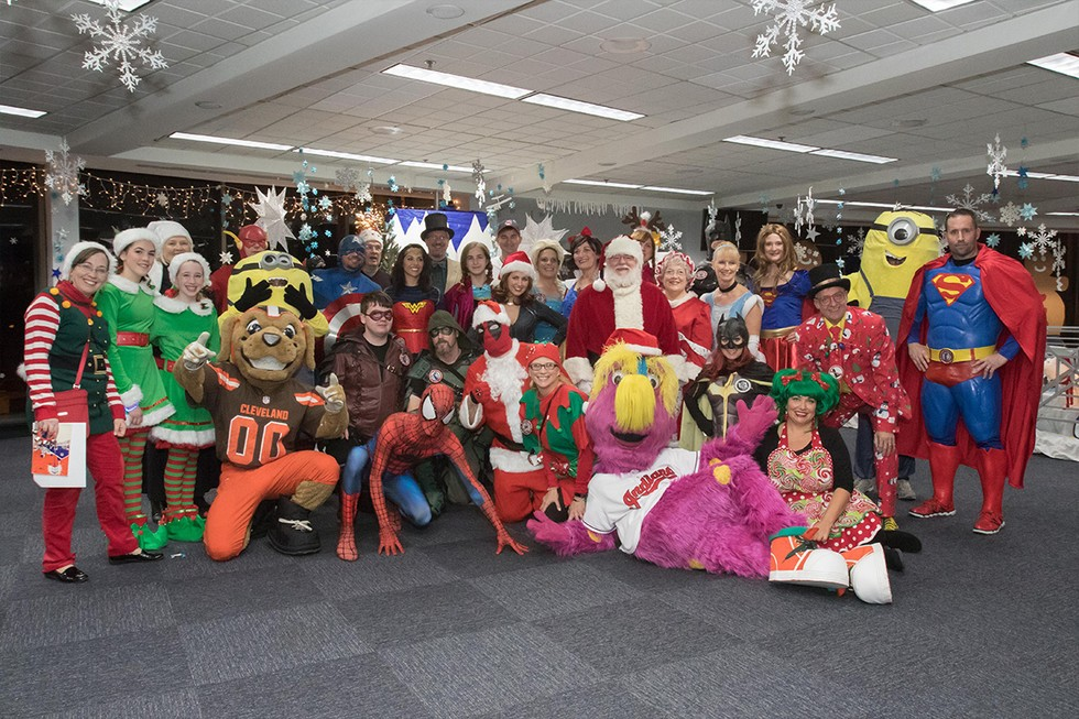 Group shot of employees dressed up in costumes for Fantasy Flights festivities