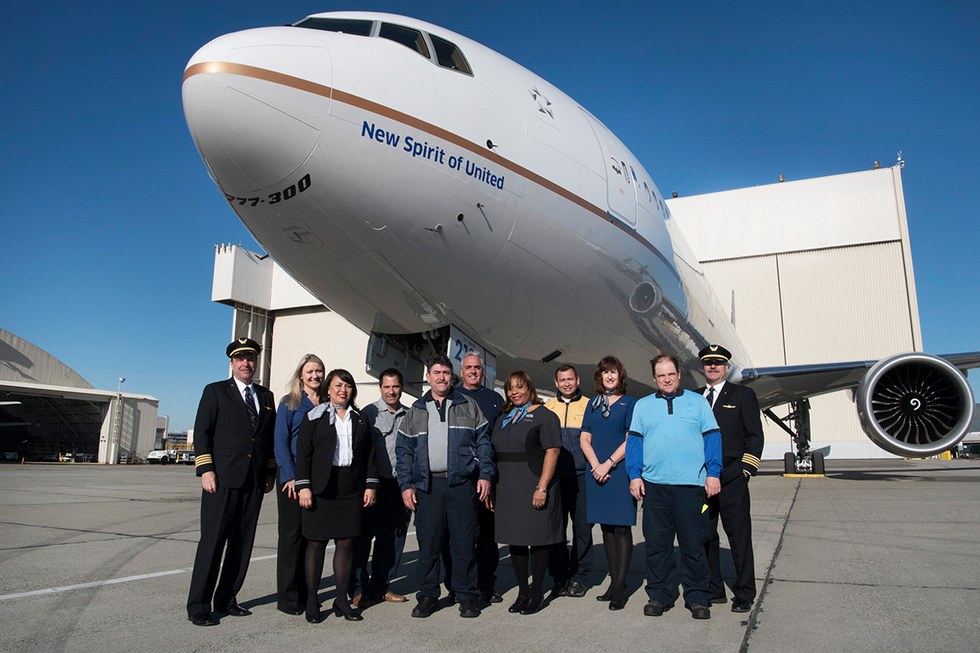 Employees pose with the New Spirit of United