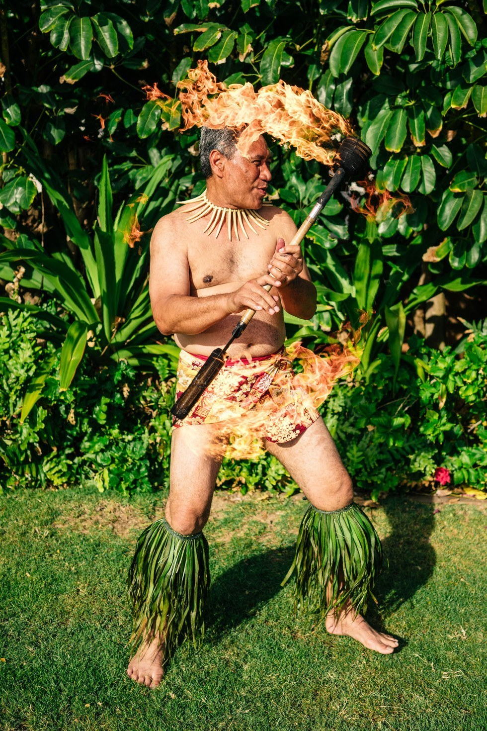 Faafetai Tialino in traditional luau dance-and-dinner outfit
