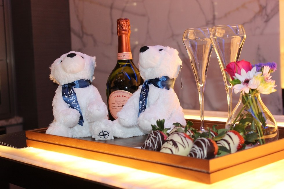 Champagne, chocolate covered strawberries and Polaris bears to celebrate the engagement.