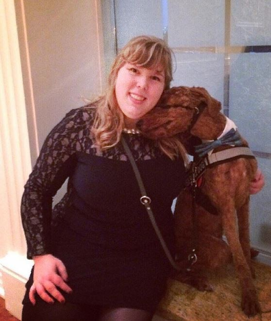 woman cuddling service dog