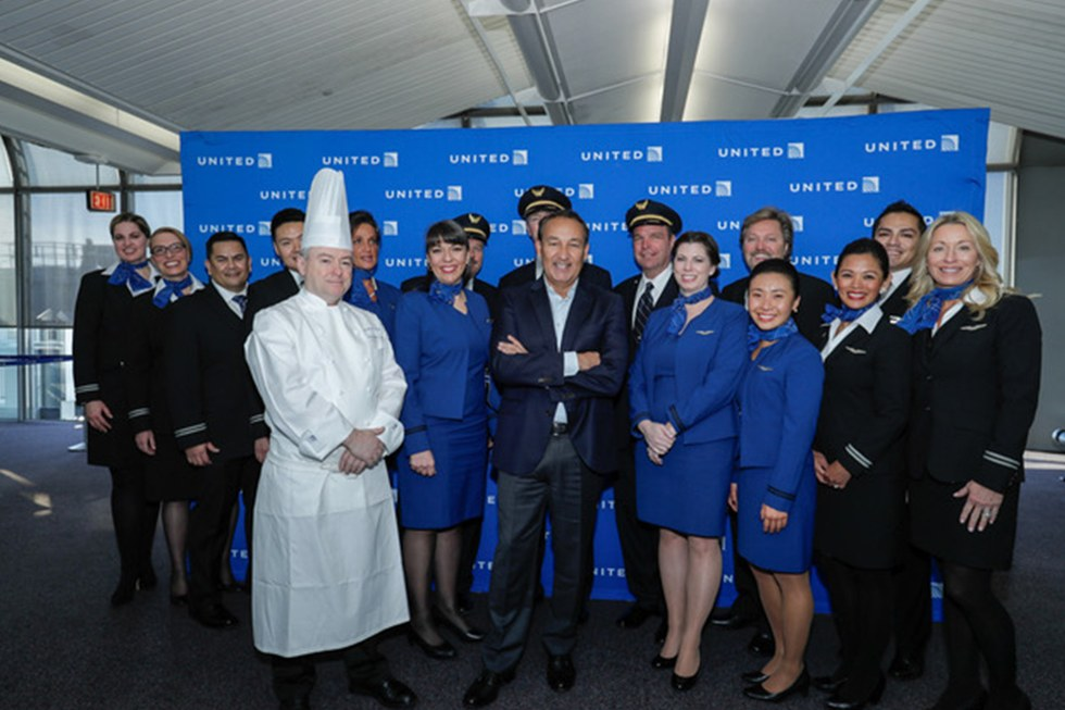 United Airlines CEO, Oscar Munoz, pictured with flight crew