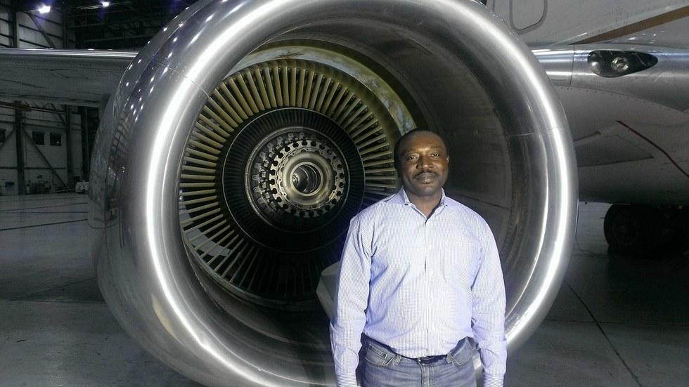 Gervais Tchoutan infront of a plane engine