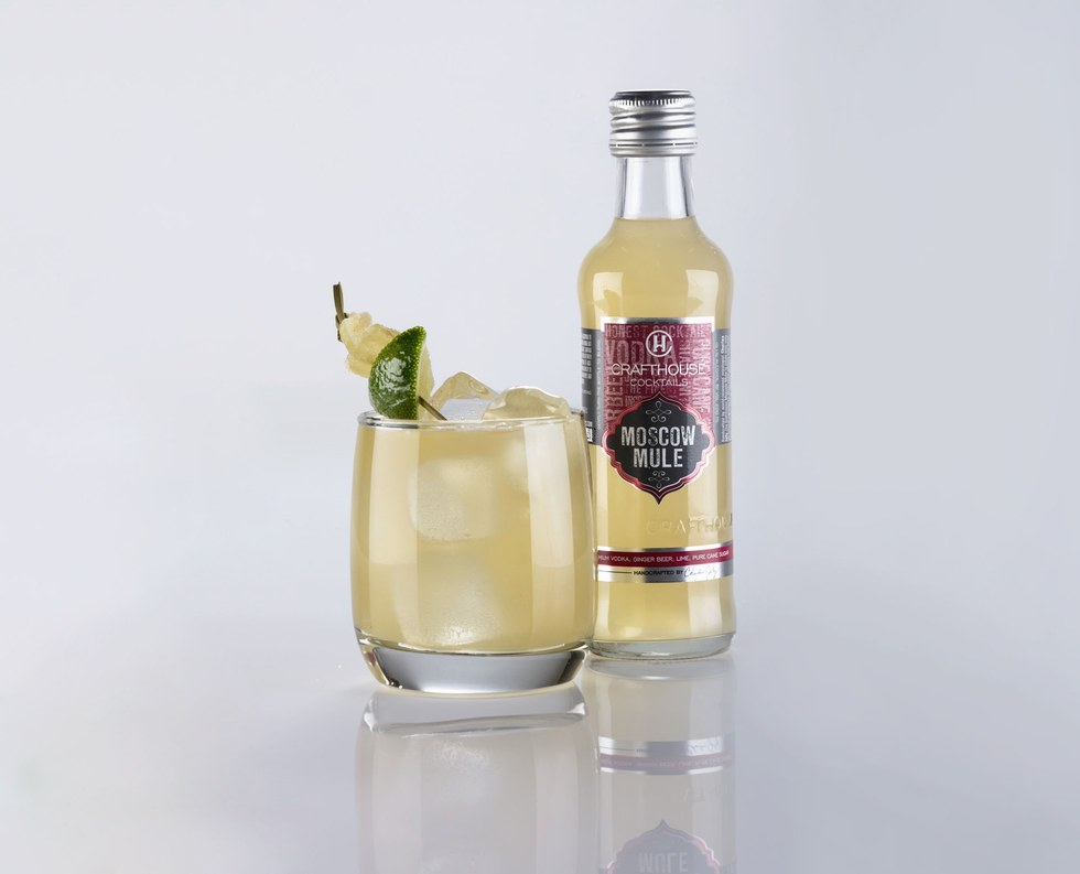 The featured cocktail is a refreshing Moscow Mule with candied ginger and fresh lime