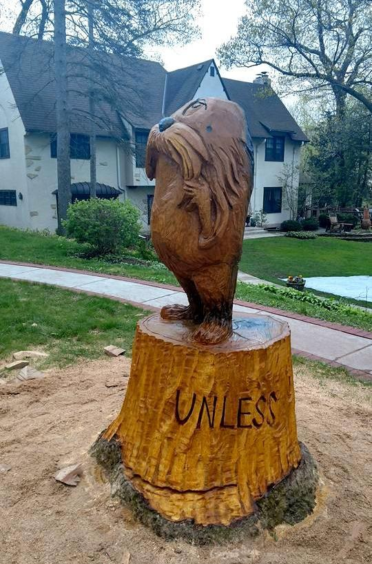 The lorax pops out of a tree stump thanks to minnesota
