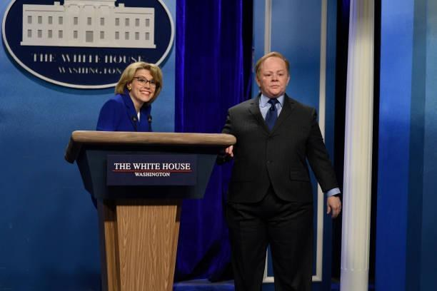 Melissa McCarthy as Sean Spicer and Kate McKinnon as Betsy DeVos