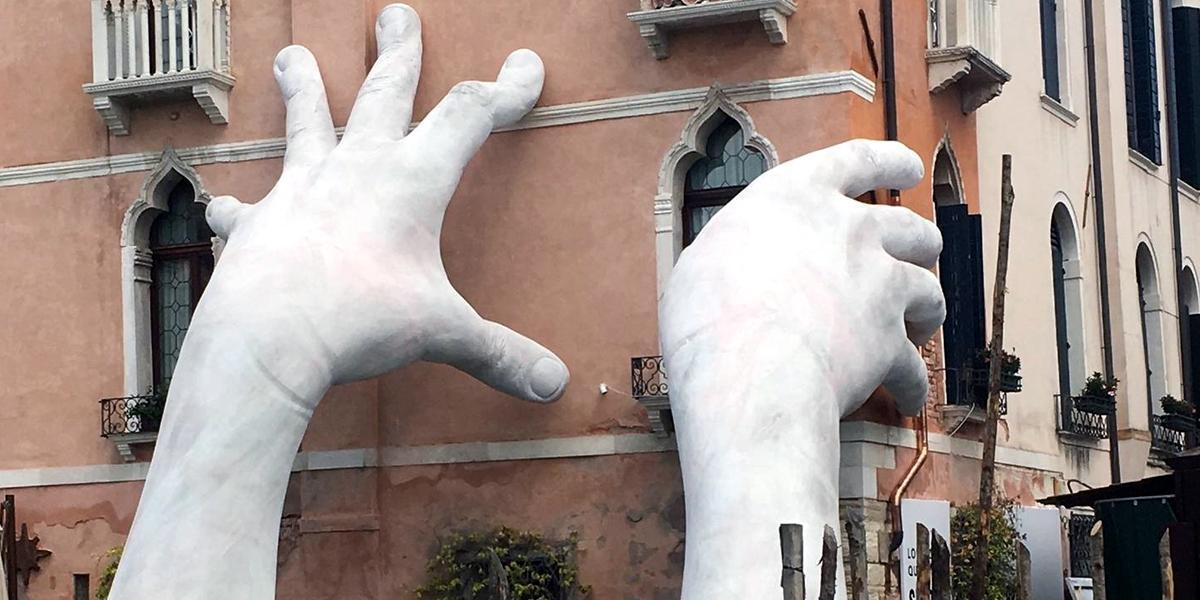 photo image Giant Hands Rise From Venice Canal, Sends Alarming Message of Sea Level Rise