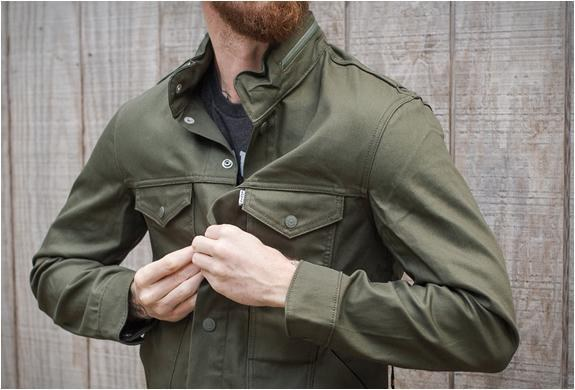 Picture of a man wearing Levi's commuter truck jacket.