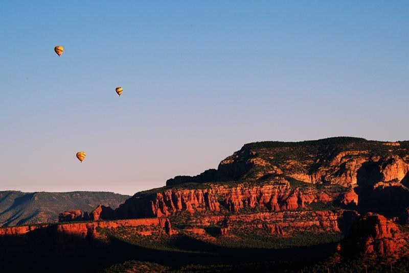 Hot air balloons in the horizon of Arizona's Red Rock State Park