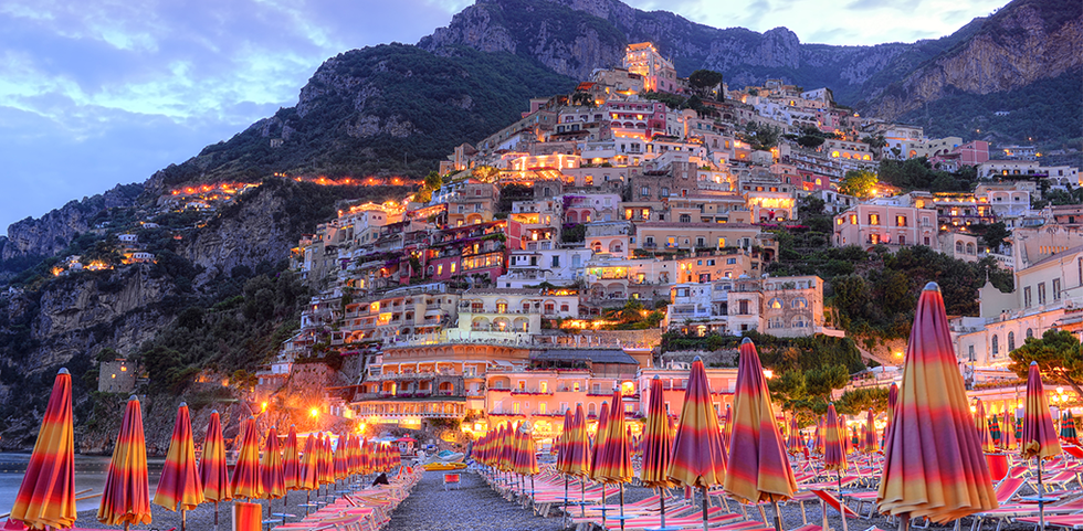 Beach view looking up at the homes built on the cliffs in Positano, Italy.