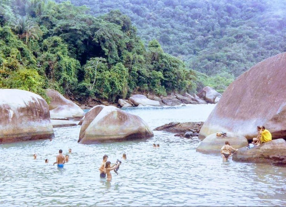 Tourists swimming at one of the many secluded beaches in Paraty.