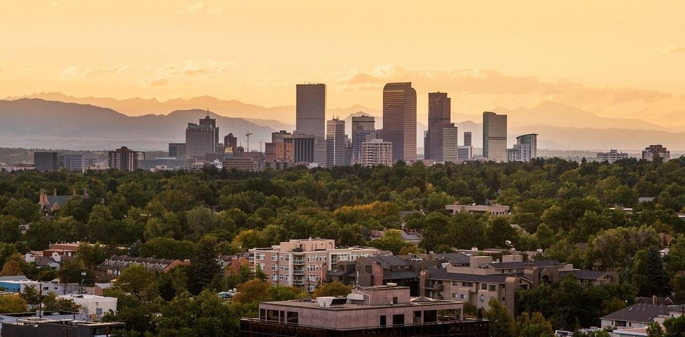 Aerial view of downtown Denver at sunset.