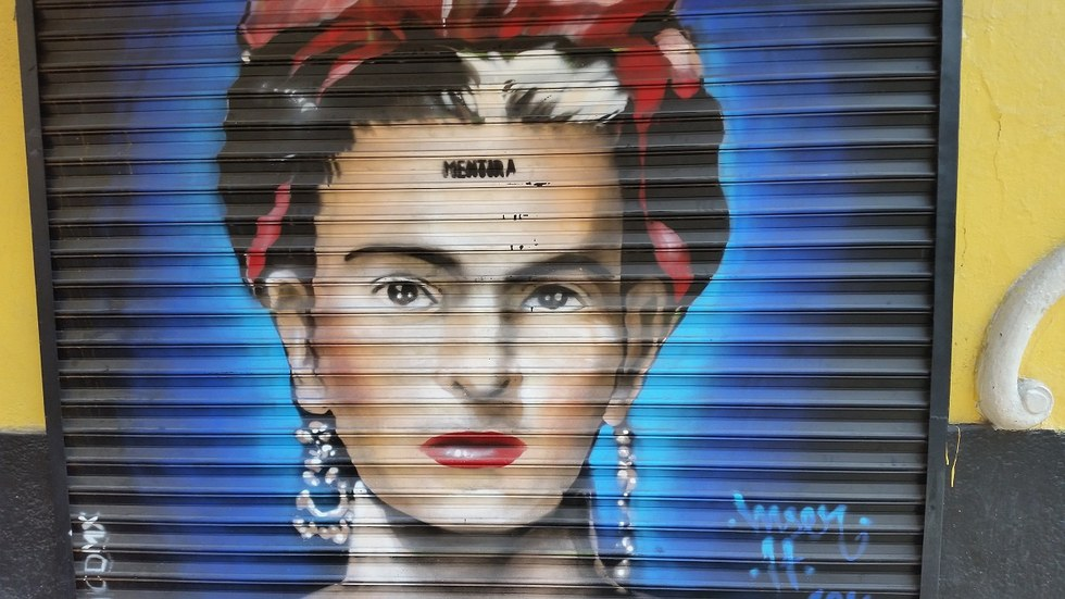 Frida Kahlo mural on a garage door.