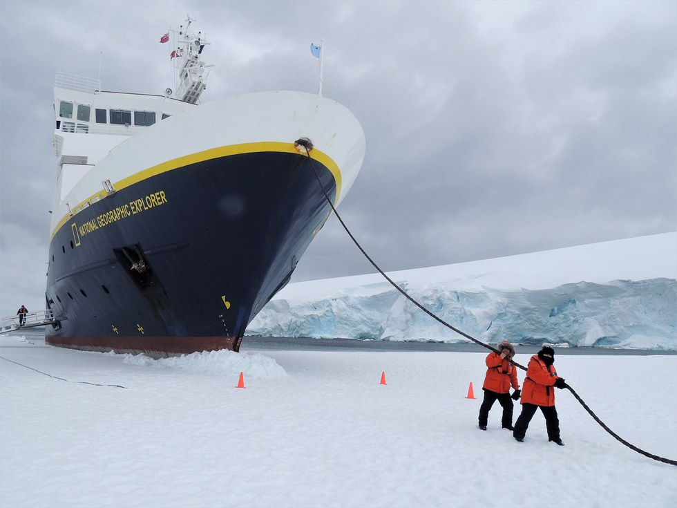 United employee, Scott Williams and his wife act out pulling the large ship through the thick ice.
