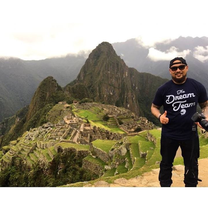 Leonida Esquieres' son on top of Machu Picchu